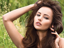 Portrait of the young beautiful woman with long hairs. Stock Image