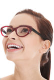 Portrait of young beautiful woman looking up and smiling. Stock Photography