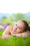 Portrait of young beautiful woman lying in grass Stock Photo
