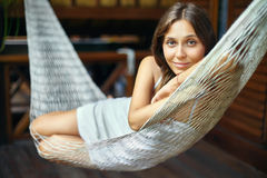 Portrait of young beautiful woman lying in hammock. In tropical resort Royalty Free Stock Photo