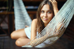 Portrait of young beautiful woman lying in hammock. In tropical resort Royalty Free Stock Image