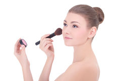Portrait of young beautiful woman with make up brush applying ro Royalty Free Stock Photography
