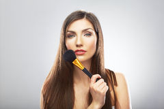 Portrait of young beautiful woman. Make up brush. Isolated Royalty Free Stock Photo