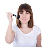 Portrait of young beautiful woman with make up brush isolated on Stock Photo