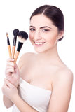 Portrait of young beautiful woman with make up brushes isolated Stock Photography
