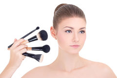 Portrait of young beautiful woman with make up brushes set isola Royalty Free Stock Photography