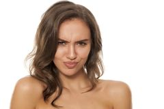 Woman with funny faces. Portrait of a young beautiful woman making funny faces on a white background Stock Photos