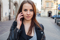 Portrait of young beautiful woman with mobile phone. Urban style Royalty Free Stock Photography