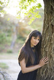 Portrait of young beautiful woman, model of fashion, in nature l Stock Photo