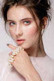 Portrait of young beautiful woman with natural beauty, nude makeup, bridal hairstyle and jewellery Stock Photos