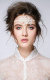 Portrait of young beautiful woman with natural beauty, nude makeup, bridal hairstyle and jewellery Stock Photography