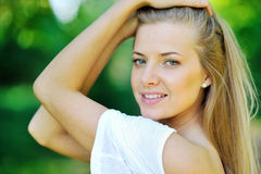 Portrait of a young beautiful woman on the nature - closeup Stock Photo
