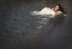 Portrait of young beautiful woman near sea Stock Photo