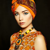 Portrait young beautiful woman with necklace. Fashion photo royalty free stock image