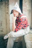 Portrait of young beautiful woman in newspaper hat. Repair home concept. Stock Photography