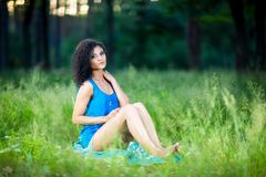 Portrait of the young beautiful woman outdoors Stock Images