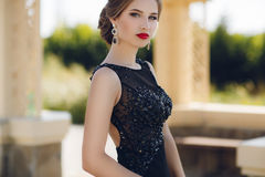 Portrait of the young beautiful woman outdoors Royalty Free Stock Image