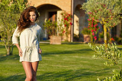 Portrait of the young beautiful  woman outdoors Stock Image