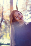 Portrait of young beautiful woman in the park with nice morning sunshine Stock Photos