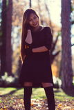 Portrait of young beautiful woman in the park with nice morning sunshine Stock Photo