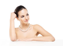 Portrait of a young and beautiful woman in a pearl necklace Stock Images