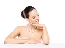 Portrait of a young and beautiful woman in a pearl necklace Stock Image