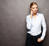 Portrait of young beautiful woman on phone call Royalty Free Stock Photography