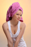 Portrait of young beautiful woman in pink towel Stock Image