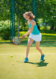 Portrait of young beautiful woman playing tennis Stock Photos