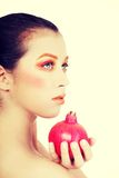 Portrait of young beautiful woman with pomegranate Royalty Free Stock Photography