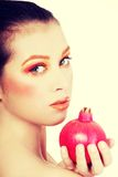 Portrait of young beautiful woman with pomegranate Stock Images