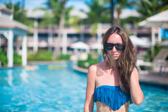 Portrait of young beautiful woman in the pool Royalty Free Stock Photos