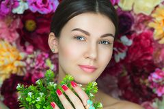 Portrait of young beautiful girl near flowers royalty free stock photography