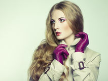 Portrait of young beautiful woman in purple gloves Royalty Free Stock Photo