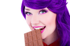 Portrait of young beautiful woman with purple hair biting chocol Royalty Free Stock Photos