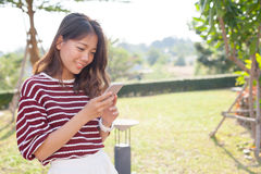 Portrait of young beautiful woman reading message text on mobile Royalty Free Stock Image