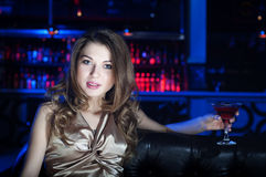 Portrait of the young beautiful woman, rest in bar Royalty Free Stock Image