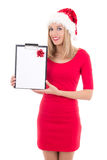 Portrait of young beautiful woman in santa hat with gift list is Stock Image