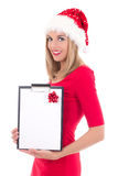 Portrait of young beautiful woman in santa hat with gift list is Royalty Free Stock Photos