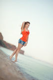 Portrait of young beautiful woman on the seashore sand Royalty Free Stock Photos