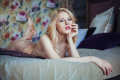 Portrait of young beautiful woman in seductive lingerie. Royalty Free Stock Photos