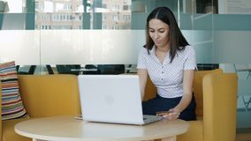 Young woman using credit card online stock footage