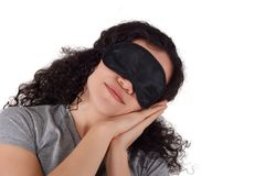 Tired girl with eye mask for sleeping. royalty free stock image
