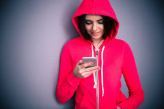 Portrait of a young beautiful woman with smartphone royalty free stock image