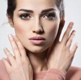 Portrait of an young beautiful  woman with  smoky eyes makeup. Stock Photos