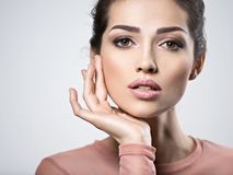 Portrait of an young beautiful  woman with  smoky eyes makeup. Royalty Free Stock Photo