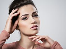 Portrait of an young beautiful  woman with  smoky eyes makeup. Royalty Free Stock Images