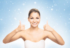 Portrait of a young and beautiful woman on the snow Stock Image