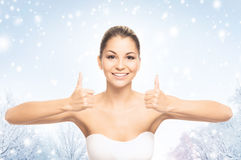 Portrait of a young and beautiful woman on the snow Royalty Free Stock Image