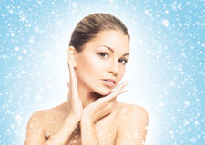Portrait of a young and beautiful woman on the snow Royalty Free Stock Photos